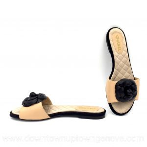 Chanel slides in beige with black camellias