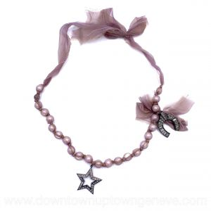 Lanvin necklace in faux pearls with star and horse-shoe charm on lilac silk