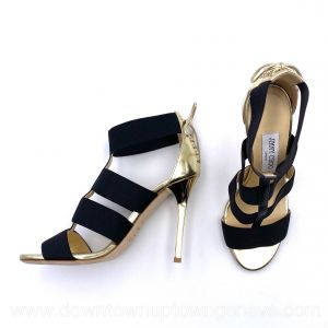 Jimmy Choo sandals with black elastic bands with metallic gold heel and laces trim on heel