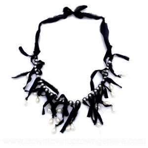 Lanvin necklace in faux pearls and hanging faux pearls on black silk