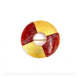 YSL vintage brooch in round gold-tone metal & amber resin