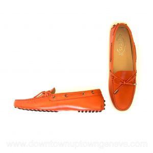 Tod's boating shoes in orange leather